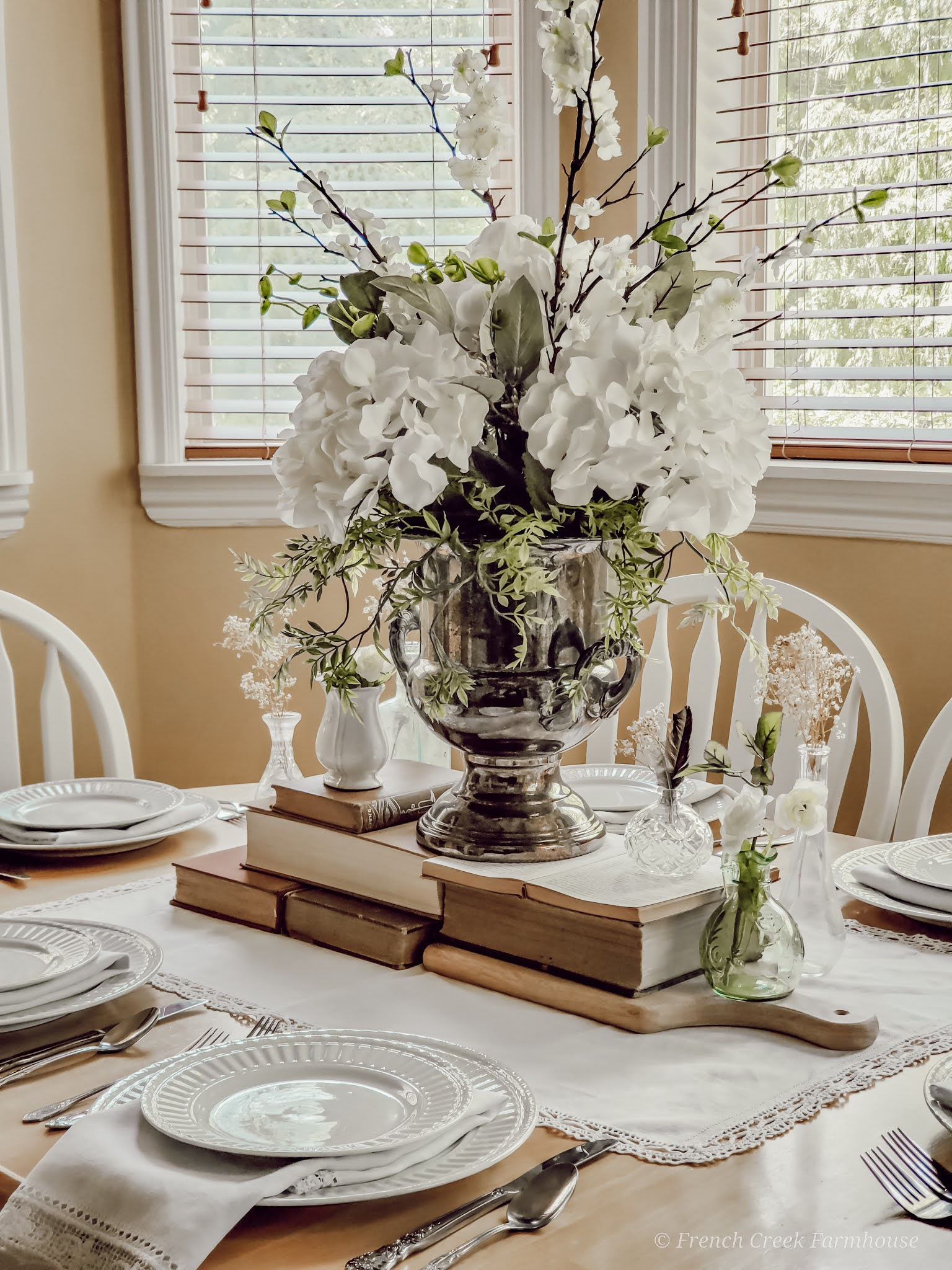 Vintage champagne bucket filled with hydrangeas make a lovely centerpiece