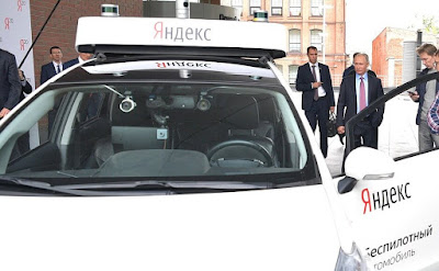 Vladimir Putin is shown a working prototype of a driverless car during his visit to Yandex Moscow office.