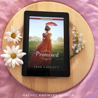 Ebook cover of Promised by Leah Garriott on wooden plate with flowers