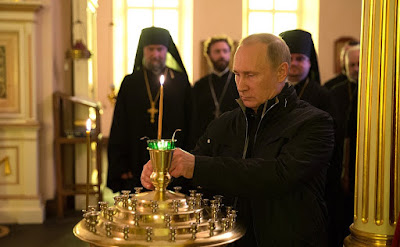 Vladimir Putin in Church.