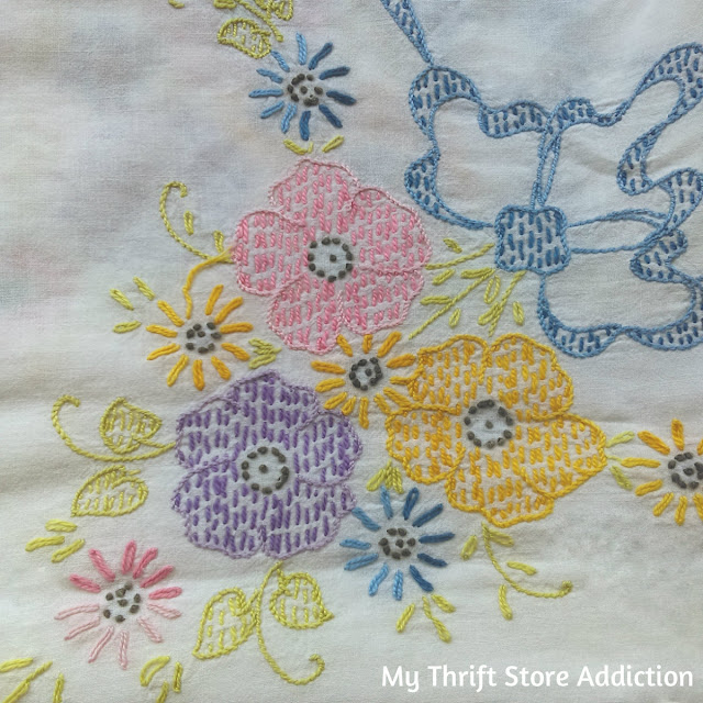 embroidered vintage coverlet