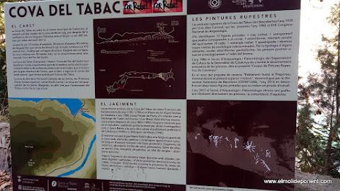 Cartell informatiu de la cova del tabac
