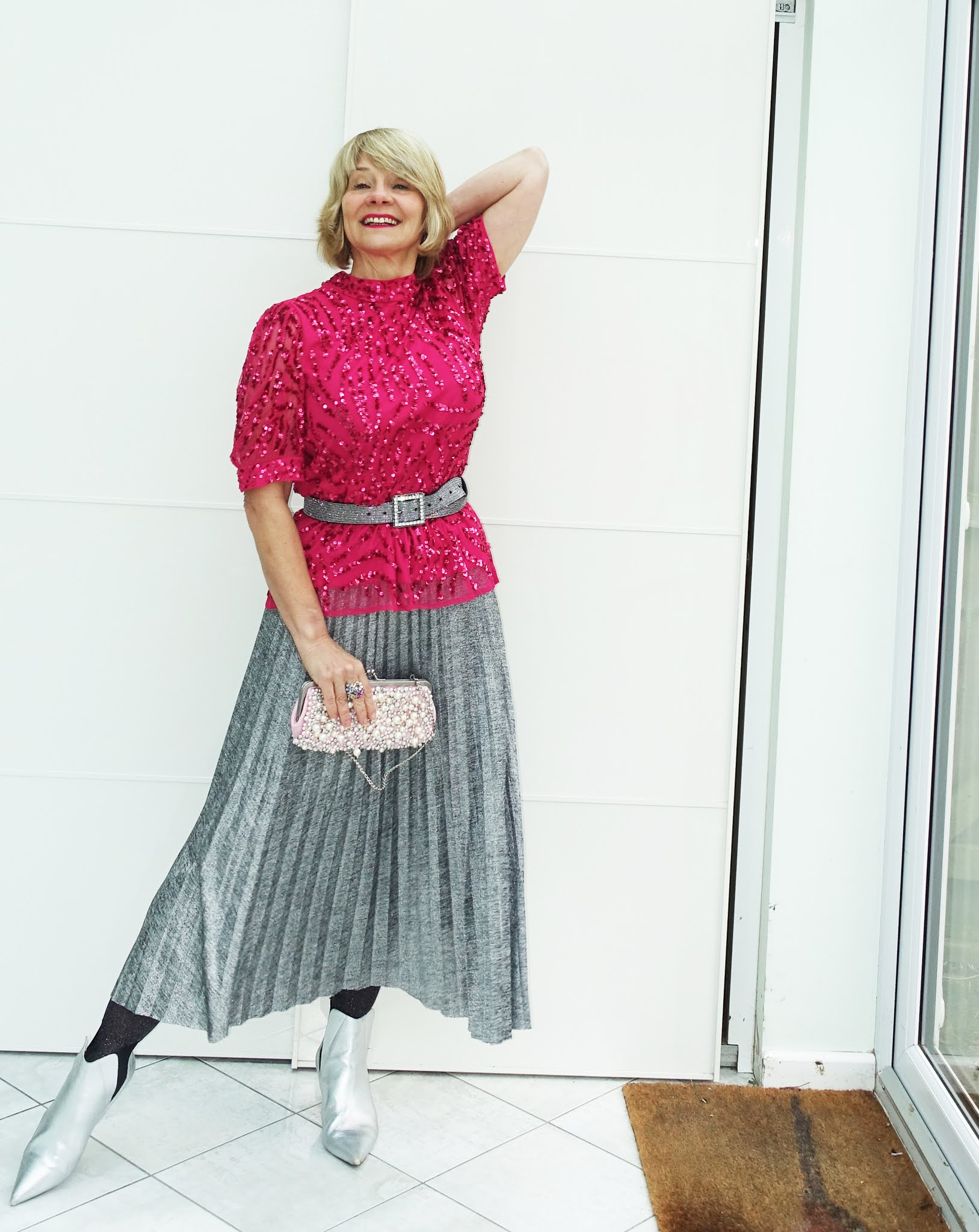 All we want for Christmas in pandemic year is a bit of sparkle and here it is provided by the over-40s bloggers of the Style Not Age challenge. Here Gail Hanlon from Is This Mutton wears a deep pink sequinned tunic from Monsoon with a midi pleated silver skirt and silver boots