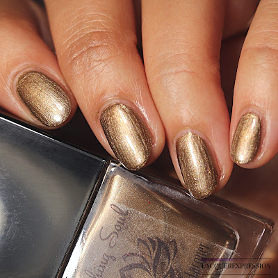 Nail polish swatch of Pecan Pie by Soothing Soul Nail Lacquer is a warm gold polish with foil finish