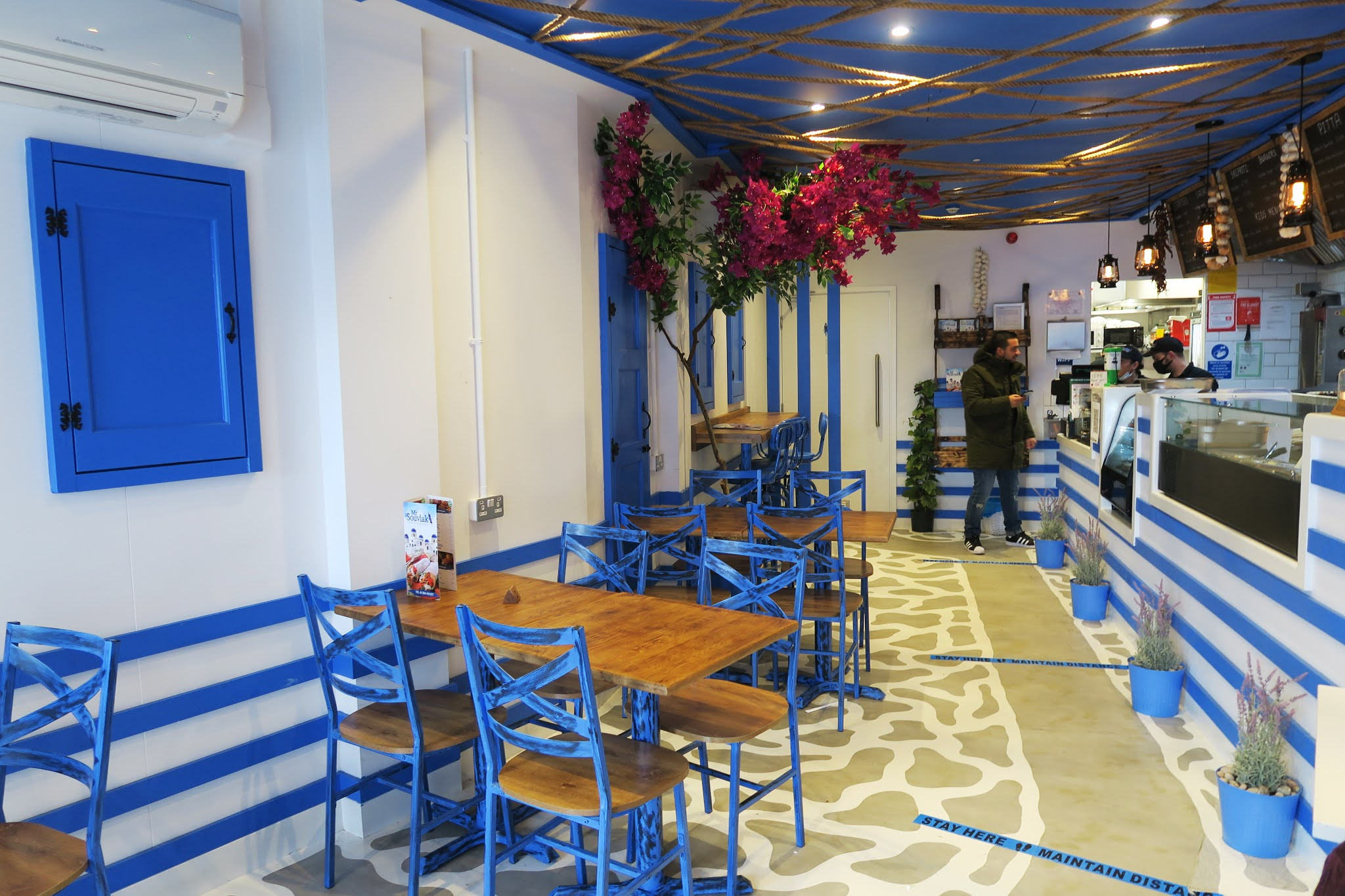 Inside Mr Souvlaki restaurant in Stourbridge. The interior is decorated to look like a white-washed greek town.