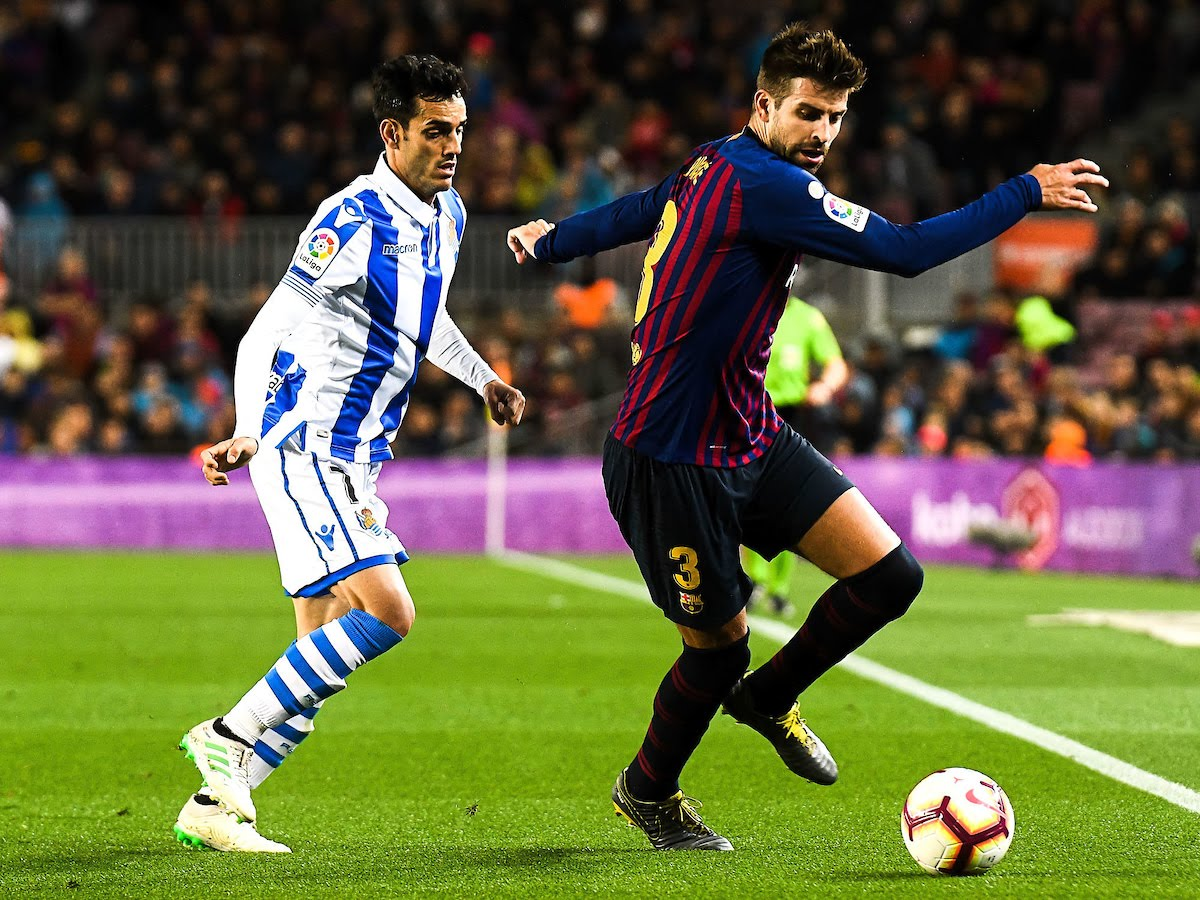 Gerard Pique of FC Barcelona and Juanmi Jimenez of Real Sociedad during the match between FC Barcelona vs Real Sociedad of La Liga, date 33, 2018-2019 season.