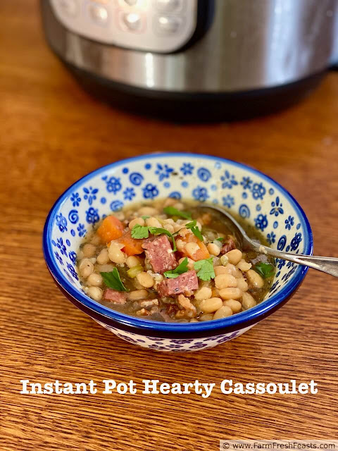 A hearty bowl of tender beans studded with chunks of sausage and vegetables in a simple broth. This comforting recipe is an excellent use of pressure cooking to create a warm nutritious meal without having to remember to pre-soak beans.