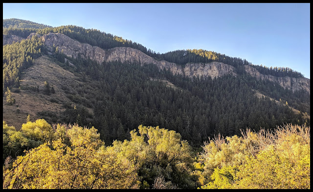 View of a beautiful cliff line called the China Wall across Logan Canyon from the Wind Caves Trail
