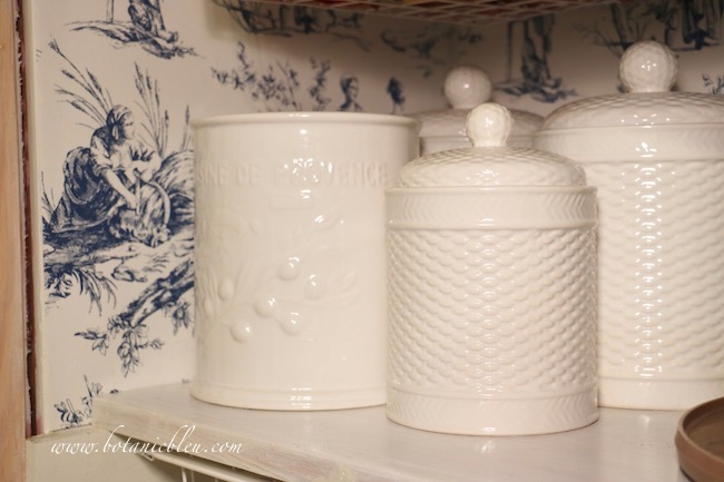French Country Pantry Makeover with small white basket weave canisters to hold snacks