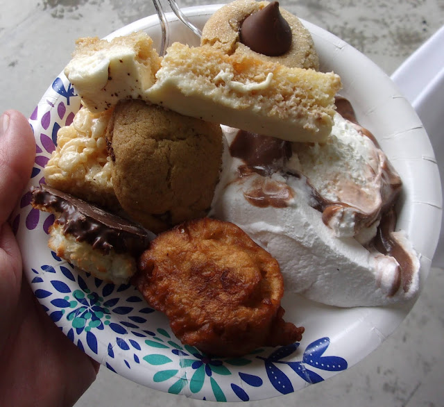 picture of cookies, cakes, ice cream, and other sugary treats on a paper plate