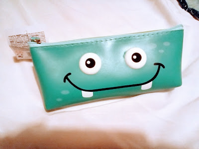 photo of pencilcase with a monster's face :-)
