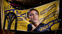 Alexandria Ocasio-Cortez campaign poster (Credit: Scott Heins / Getty Images) Click to Enlarge.