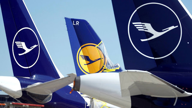 Tails of Lufthansa aircraft lined up at the airport