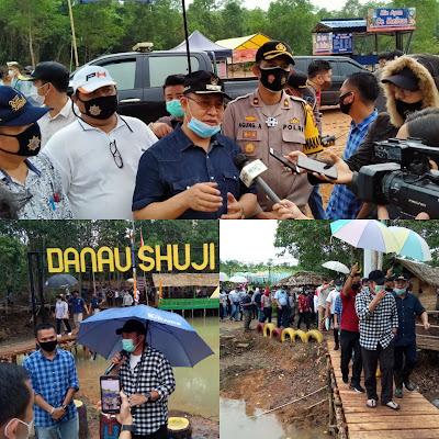 Bupati Muara Enim dan Wakapolres Muara Enim saat mendampingi Gubernur Sumsel melakukan kunjungan ke lokasi wisata Danau Shuji Lembak