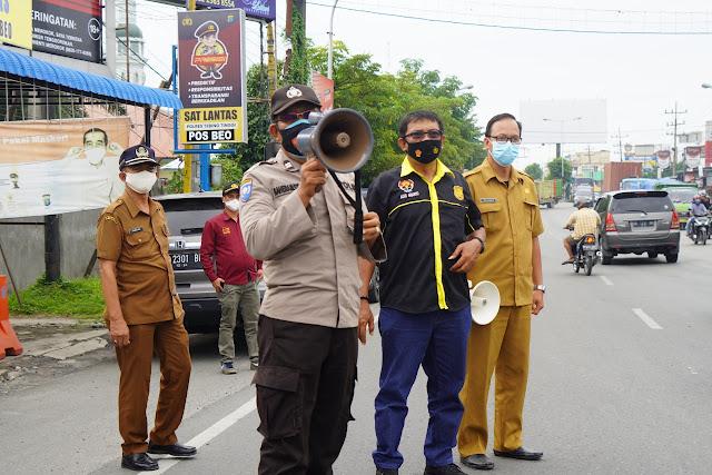Satgas Covid-19 bersama Polres Tebingtinggi Sosialisasikan Penanganan Covid-19 Himbau Warga Mematuhi PPKM Darurat Kota Medan