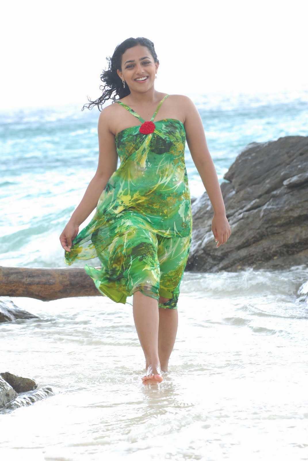 Malayalam Actress Nithya Menon Wet Hot Legs Show Photoshoot In Green Dress