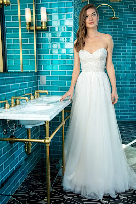 Enaura Bridal Strapless a-line Bridal Dress with beaded throughout