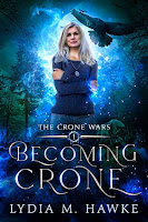 A cover of Becoming Crone showing an older woman with shoulder-length silver hair in jeans and a long-sleeved blue top, her arms crossed over her chest. She's illuminated by white-blue light from behind. On her left, a large crow flies above her and there are many smaller ones in the air. There are fir trees in the background