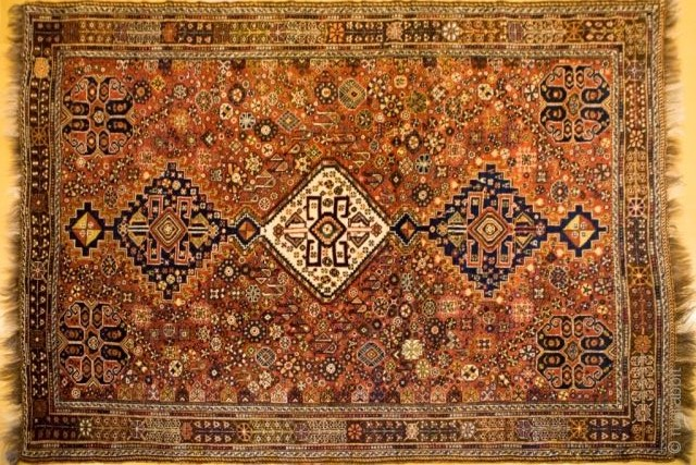 A piece of Qashqai rug with geometrical margins.