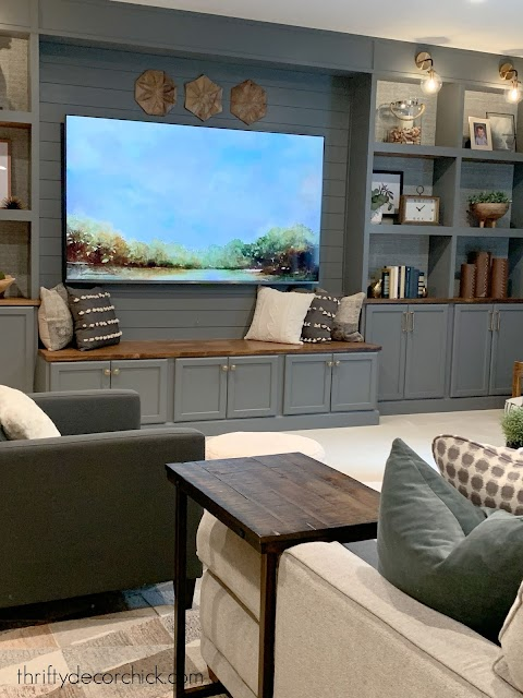 Built in wall with wood bench under TV