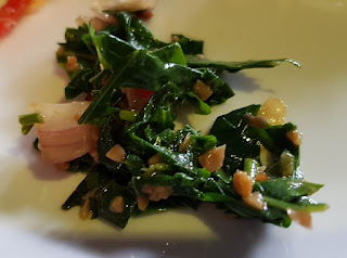 Urap singkong. This salad is made with finely shredded tapioca leaves.