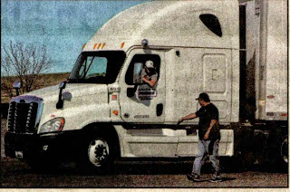 CDL_College_instructor_Rod_Williams_stands_on_the_truck_instructing