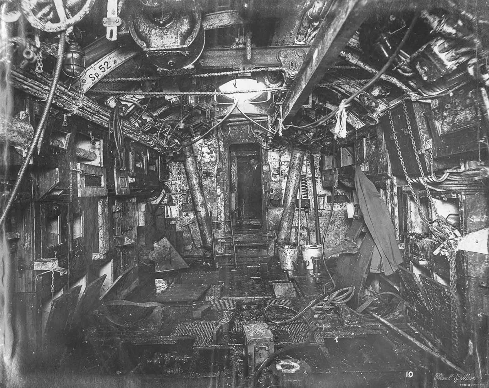 Torpedo room looking aft. The beam for lifting torpedoes into place is overhead.