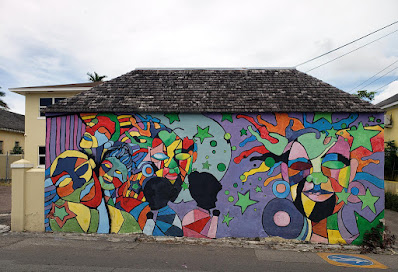 Colourful mural on side of small building