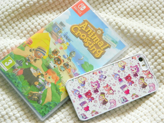 A photograph of the Animal Crossing: New Horizons Nintendo Switch game and a matching phone case