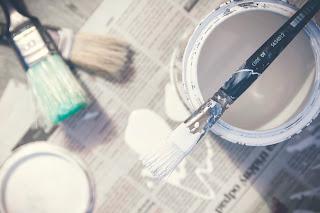 Paint pots on paper background