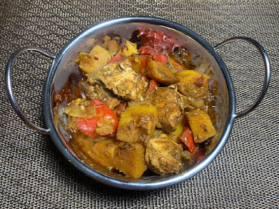 Slow Cooker Chicken and Butternut Squash Curry in a traditional curry bowl