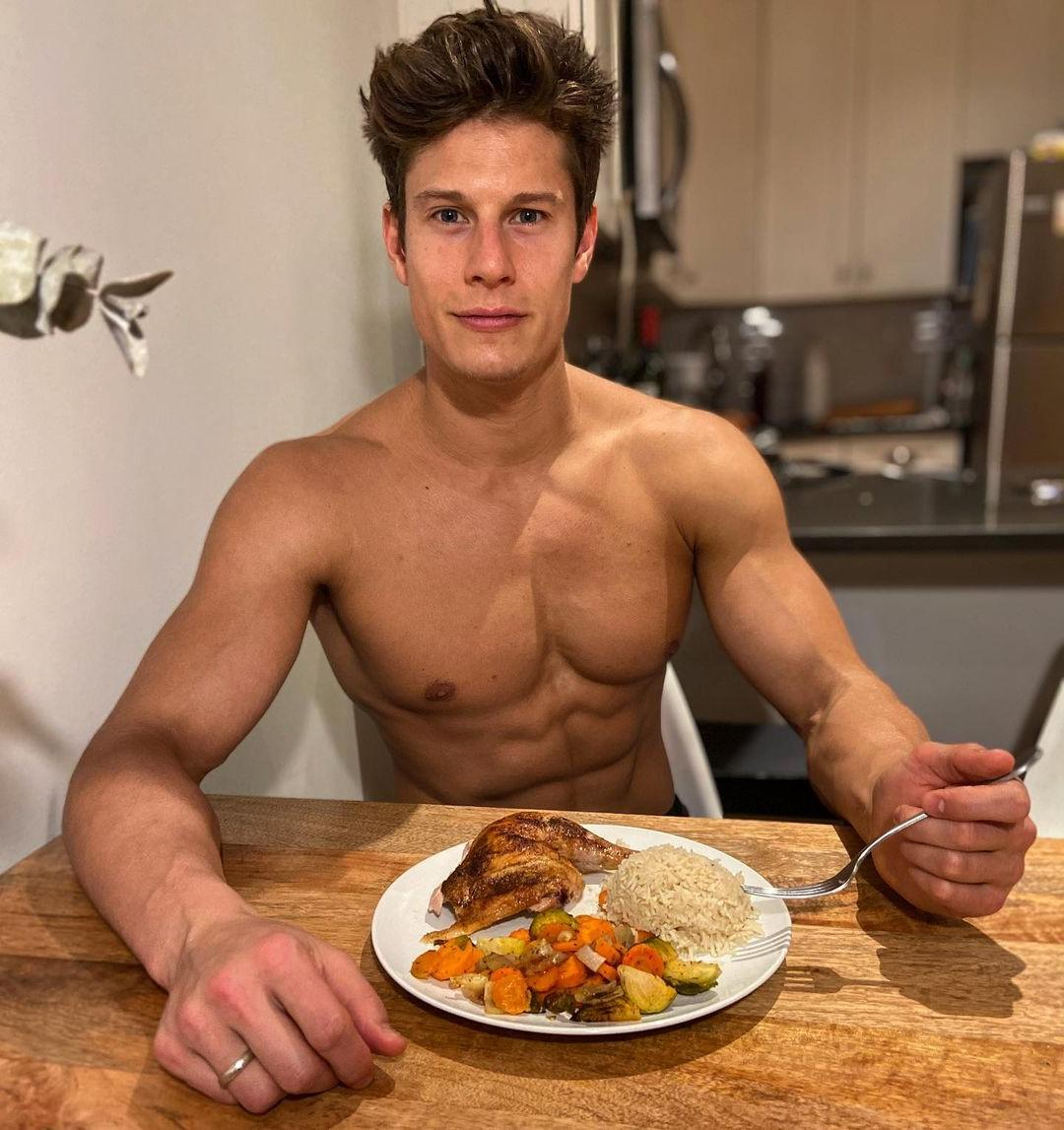 handsome-young-fit-shirtless-male-model-eating-healthy-food