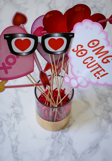 Photo booth props at a Simple Valentine's Day party, Valentine's Day playdate, or Galentine's Party!