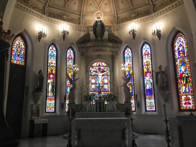 the altar and beautiful stained glass inside St. Patrick Cathedral in downtown Fort Worth, Texas