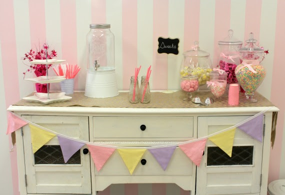 image of vintage dresser with birthday party lolly buffet and pink striped wall