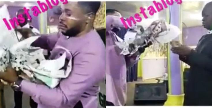 [VIDEO] Nigerian Pastor Seen Turning Newspaper Into Money Inside Church