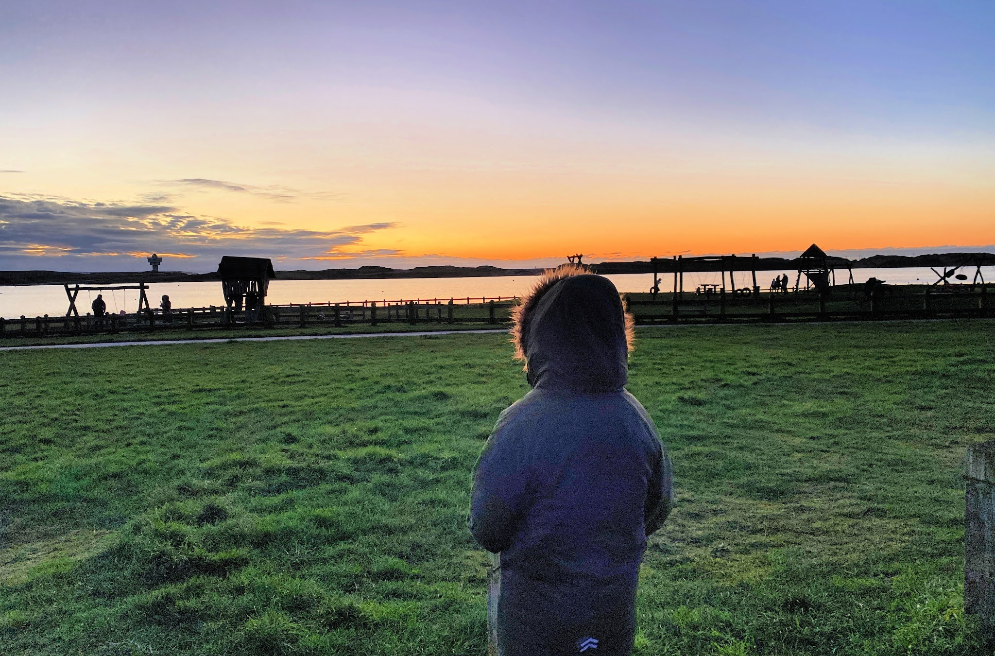 boy looking at the sunset