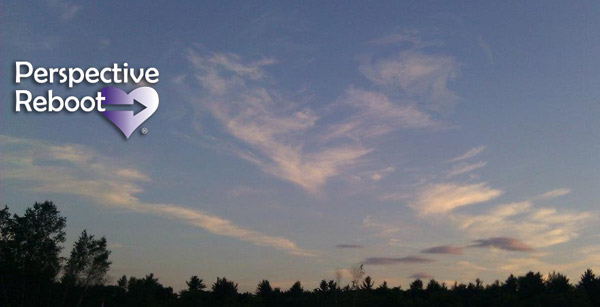 Heart-shaped cloud in blue sky. Kristi Borst's Perspective Reboot registered TM spiritual energy healing process.