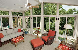A beautiful image of white roofed sunroom with red and white couch