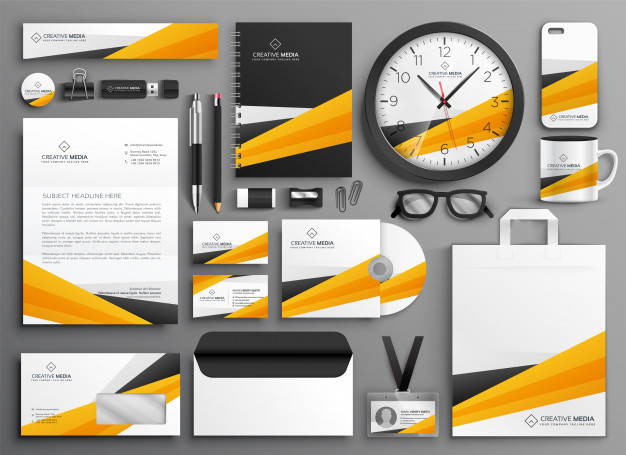 Abstract yellow business stationery set Free Vector