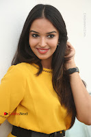 Actress Poojitha Stills in Yellow Short Dress at Darshakudu Movie Teaser Launch .COM 0166.JPG