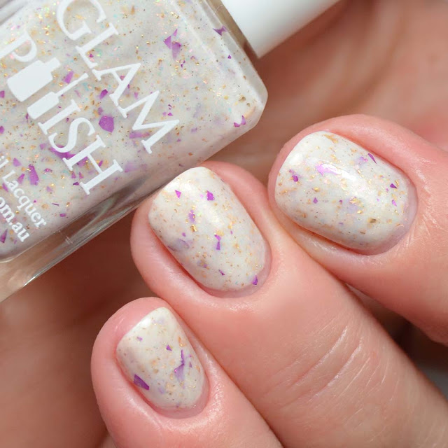 cream nail polish with flakies three finger swatch