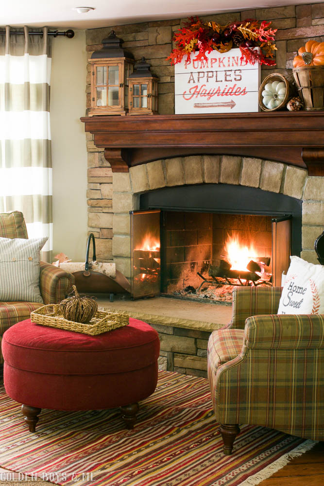 Fall mantel decor in family room with stone fireplace