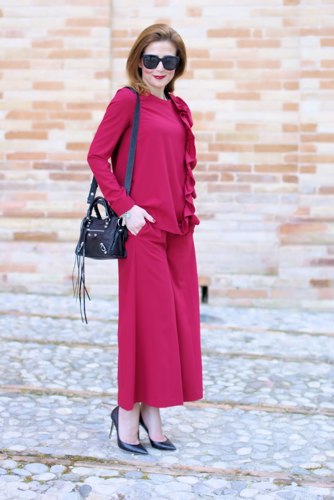 Woman in red with a ruffled blouse and wide leg cropped pants, Le Silla shoes on Fashion and Cookies fashion blog, fashion blogger style