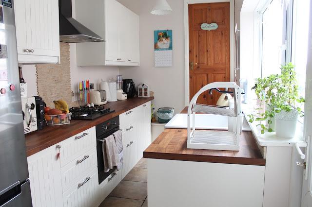 white shabby chic kitchen with dark wood worktops
