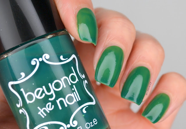 beyond the nail green thermal nail polish swatch holding bottle