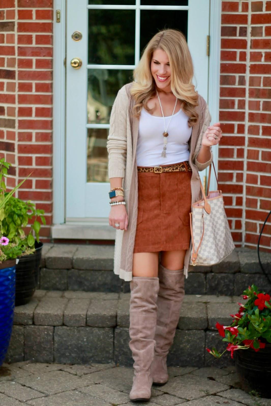 burnt orange corduroy mini skirt, leopard belt, tan cable knit cardigan, OTK taupe boots, LV neverfull