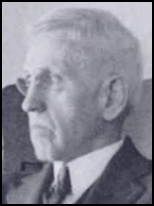 Profile shot of a scowling elderly white man with glasses and thick, white hair cut short