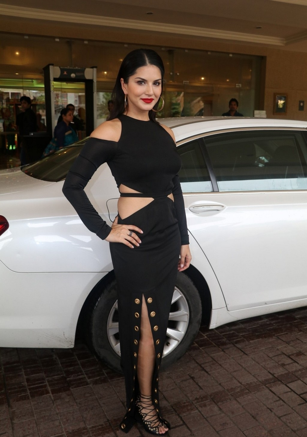 Bollywood Actress Sunny Leone Hot Legs Show Stills In Black Dress