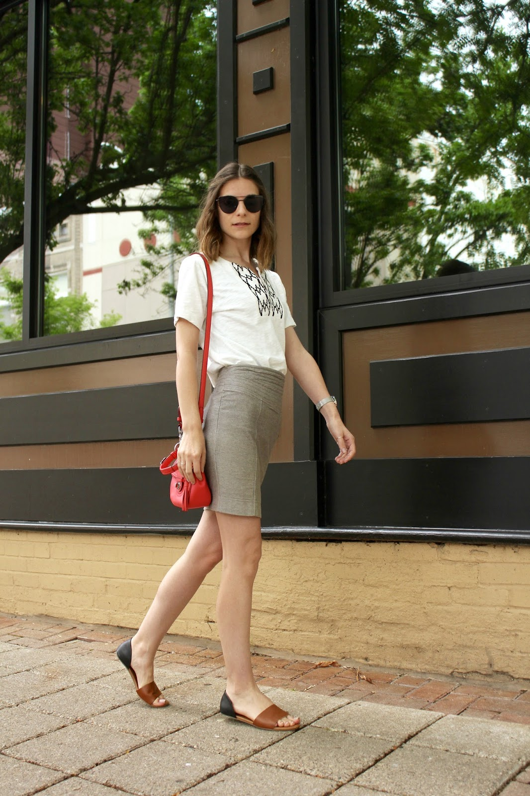 white t-shirt and gray pencil skirt
